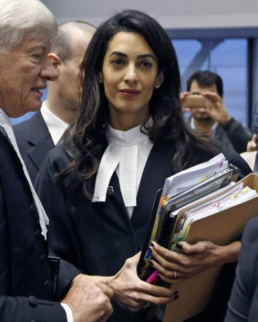 Human rights lawyer Amal Clooney arrives with her collegue Robertson to attend a hearing at the European court of Human Rights in Strasbourg