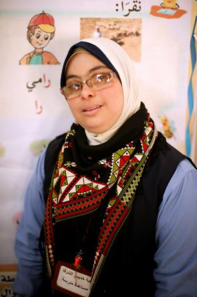 "Hiba Al-Sharfa poses for a photograph. According to one of Al-Sharfa's colleagues, this is a first for the Gaza school which is making strides in challenging stereotypes. ""Hiba has become the first Down syndrome teacher, at the 'Right to Live' Society, because she proved herself and challenged her disability, and this is how she became the first teacher with Down syndrome in all of the Strip,"" said special education teacher Nawal Ben Saeed.  REUTERS/Suhaib Salem"